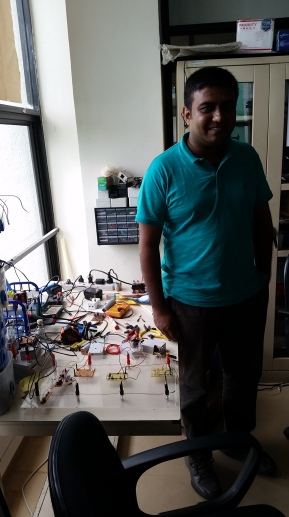 Chathura Suduwella at the Sustainable Computing Research Lab at the University of Colombo. The tangle of wires next to him represents a possible innovation in electric fencing that can help farms and villages protect themselves from elephants.